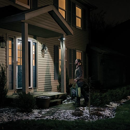 500 Lumen Floodlight lit on front porch with man entering door
